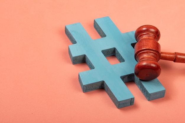 Hashtag and justice hammer symbolizing internet crimes