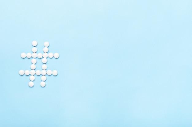 A hashtag of pills. concept medicine, health, online treatment.