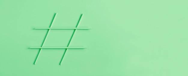 Hashtag symbol on green