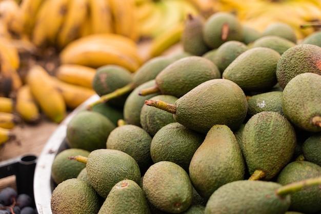 Hass avocado on the market counter. fresh green avocados.