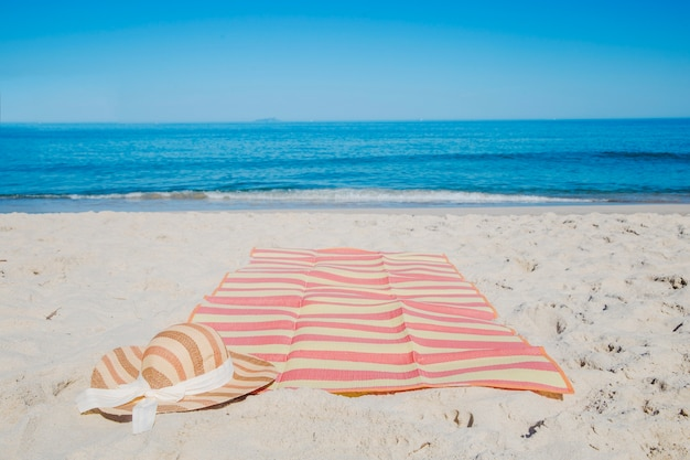 Hat and blanket on beach