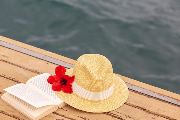Hat and book on dock