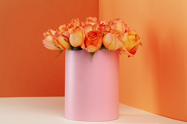 Hat box with beautiful bouquet of roses