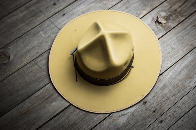 Hat of boy scout on wooden background