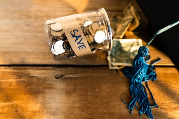 Hat graduation and money coins for saving