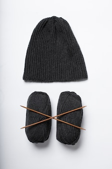 The hat is knitted in black with spokes isolated
