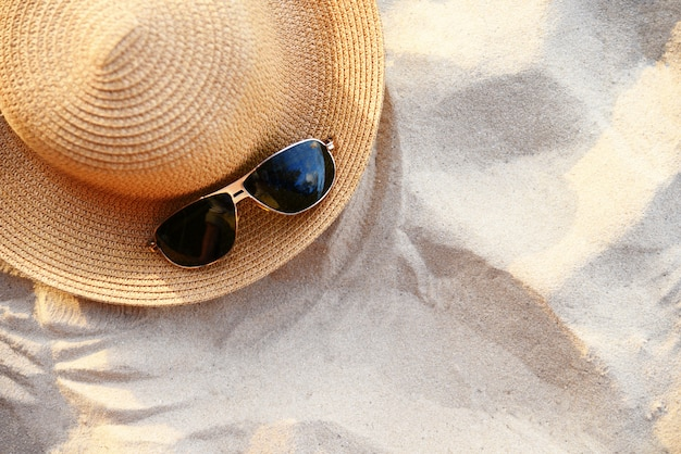 Hat summer / straw hat fasion and sunglasses accessories on sandy beach sea
