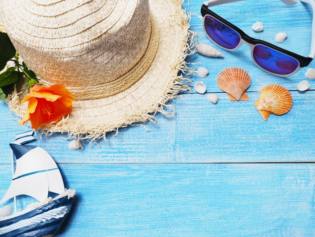 Hat and sunglasses for holiday vacation background.