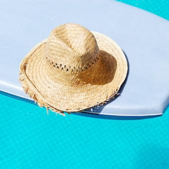 Hat in surf board