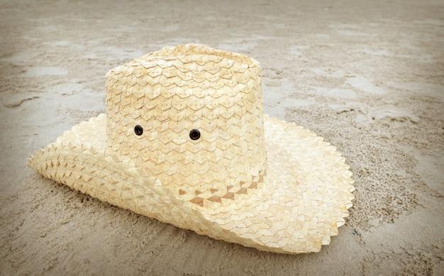 Hat on tropical island beach