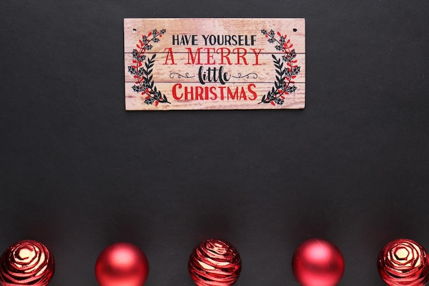 Have a merry christmas, wooden sign and xmas balls, greeting card