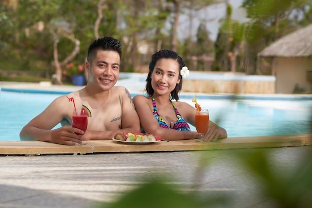 Having fun in outdoor swimming pool
