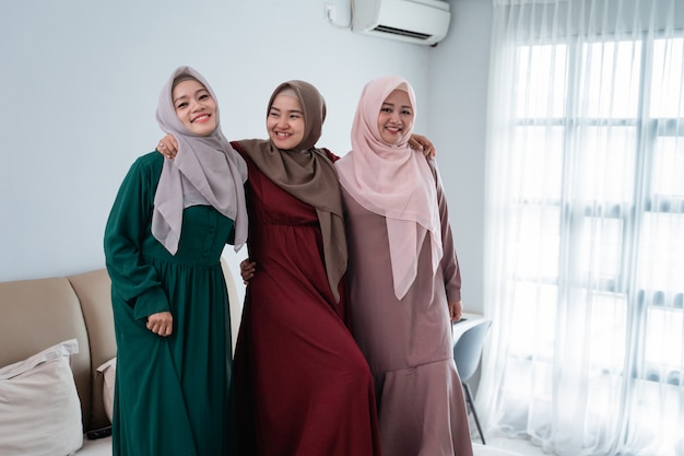 Having fun while spend time three muslim women standing in bed