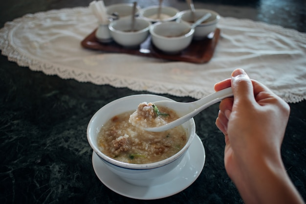 Having homemade pork congee as breakfast.