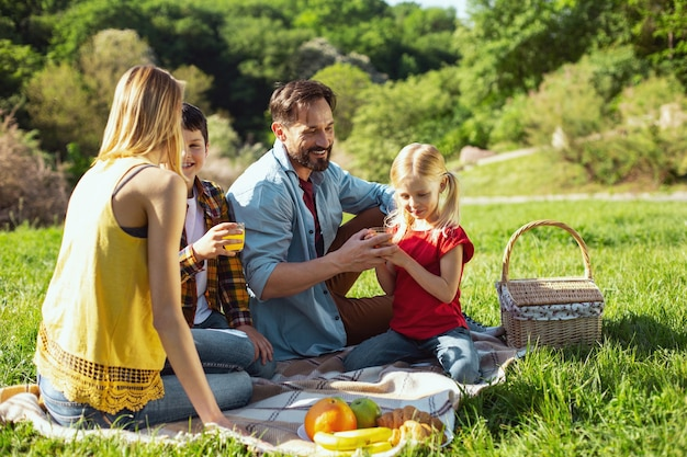 Having picnic. happy loving family spending time together and having picnic