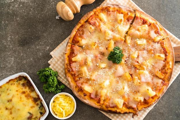 Hawaiian pizza on table