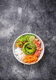 Hawaiian poke bowl with salmon, rice and vegetable