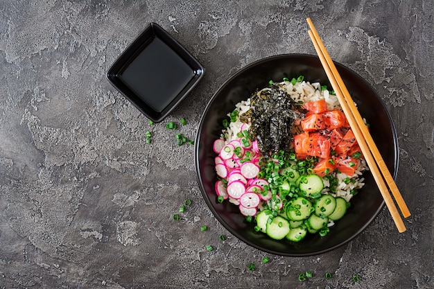 Hawaiian salmon fish poke bowl with rice. top view. flat lay