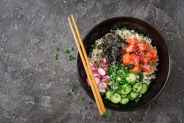 Hawaiian salmon fish poke bowl with rice. top view. flat lay