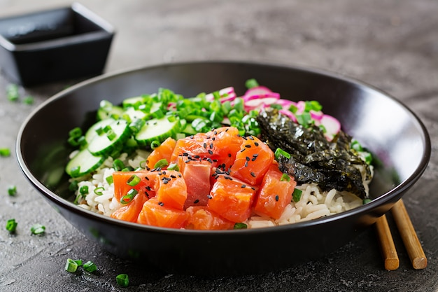 Hawaiian salmon fish poke bowl with rice