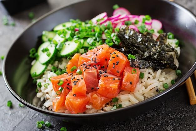 Hawaiian salmon fish poke bowl with rice