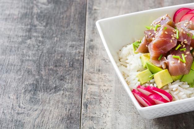 Hawaiian tuna poke bowl with avocado, radishes and sesame seeds.copy space