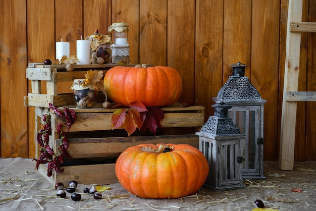 Hay, pumpkins and candles as elements of autumn scenery