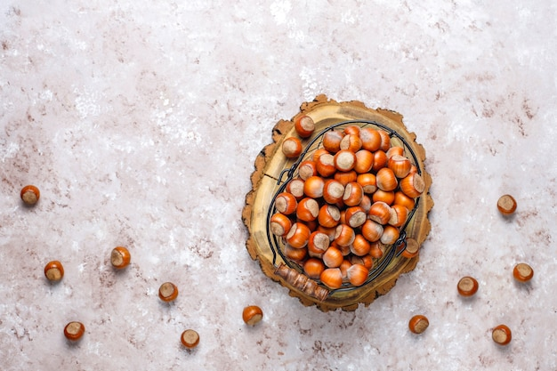 Hazelnuts on concrete background, top view