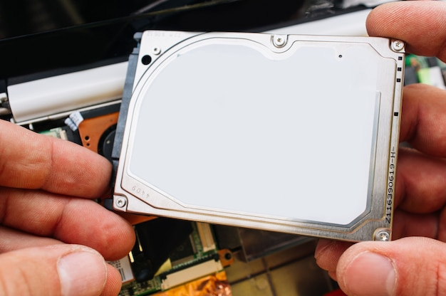 Hdd memory disk in hands