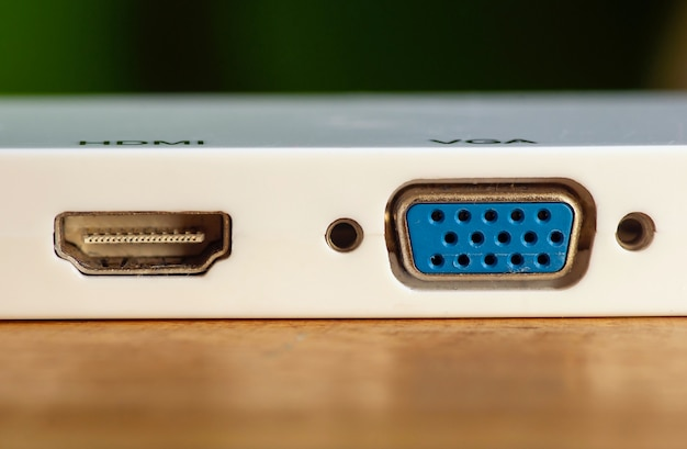 Hdmi and vga port outlet on white panel, selected focus.