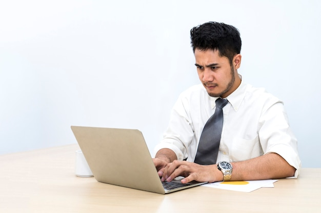 He strain and worry at office.man hands typing on computer keyboard
