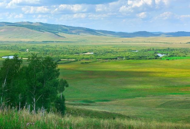 He valley of the white jus river under a blue cloudy sky. siberia, russia
