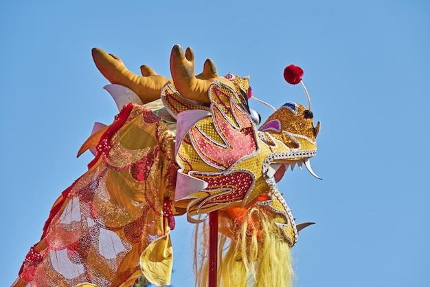 Head chinese dragonagainst blue sky during celebration of chinese new year
