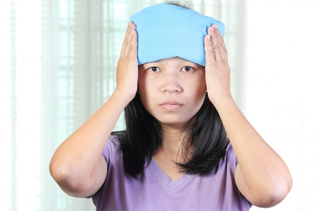 Head cold or hot therapy woman.