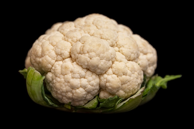 A head of fresh cauliflower. healthy eating and vegetarianism. close-up. black background.