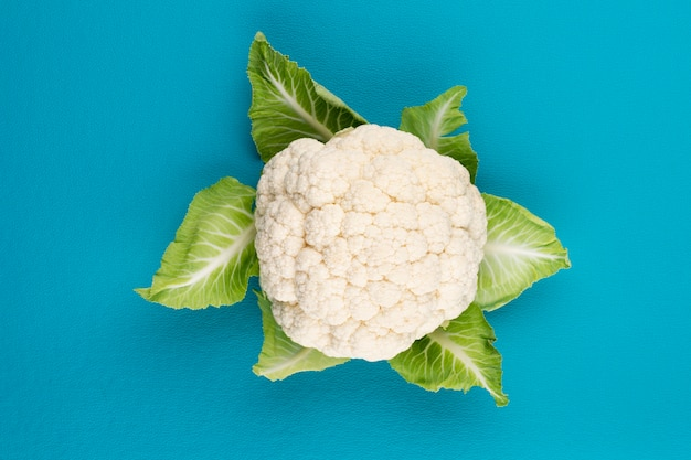 A head of fresh cauliflower. healthy eating and vegetarianism. color background.