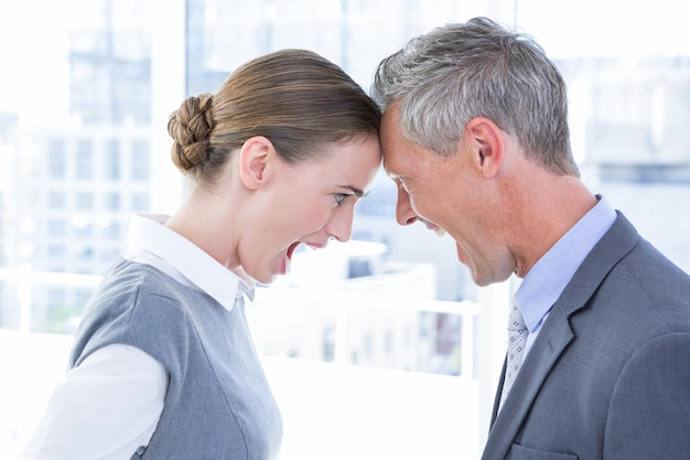 Head to head business colleagues quarreling