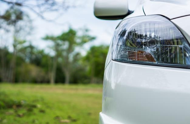 Head light of a car on green background