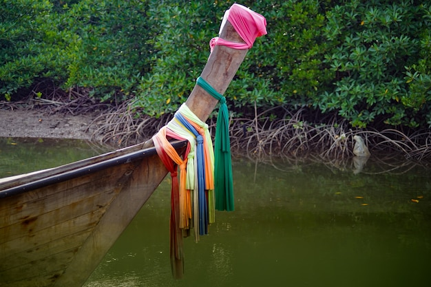 Head of long tail boat in canal. the colorful fabric is wrapped.