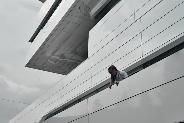 The head and shoulders of the girl on the background of the building. geometry in construction.