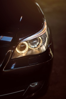 Headlight of a modern car closeup car lamp headlight exterior of a exprnsive car