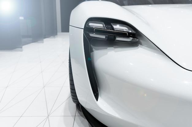 Headlight of modern prestigious car with len flare effect.