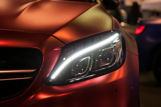Headlight of a sports car, close up.