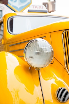 Headlight of yellow taxi