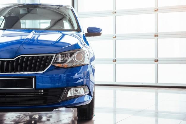 The headlights and hood blue car