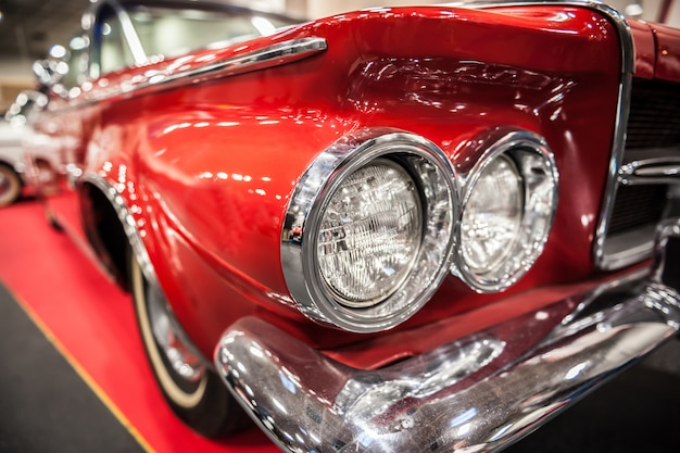 Headlights of a red vintage car