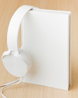 Headphone beside book on table