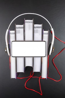 Headphones are on a stack of books