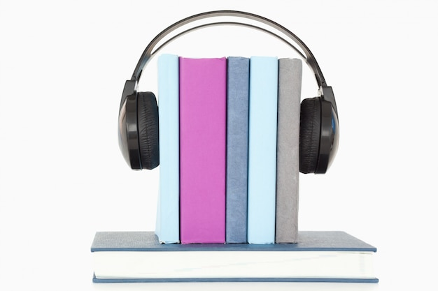 Headphones around books