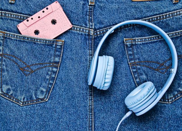 Headphones, audio cassette in back pocket of jeans